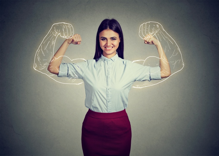 Powerful confident woman flexing her muscles.