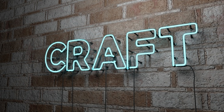 CRAFT - Glowing Neon Sign on stonework wall